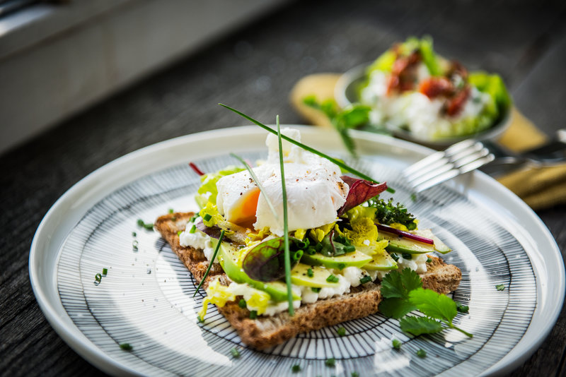 Avocado bread with poached egg on bread