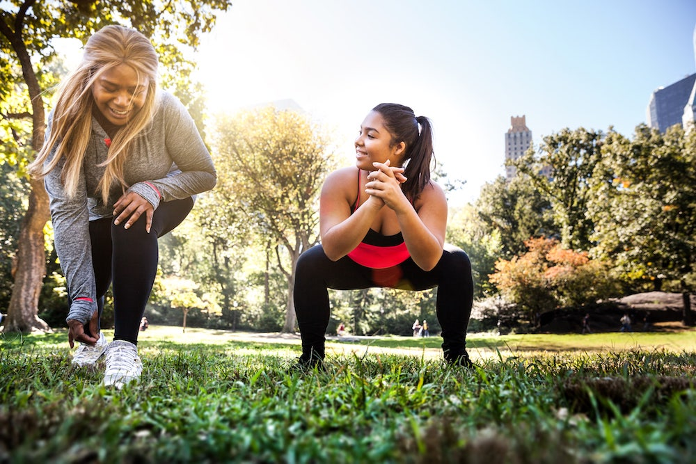 Curvy women working out in the park