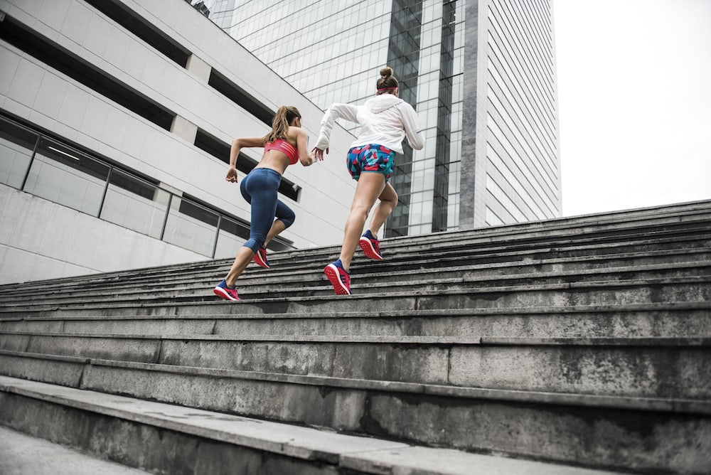 Two people running on the stairs