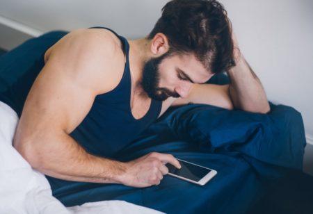 Man in bed before sleep
