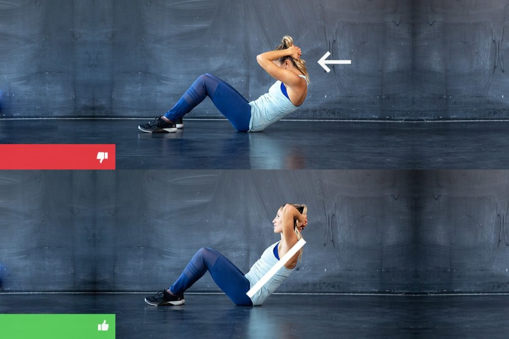 Woman showing correct sit ups