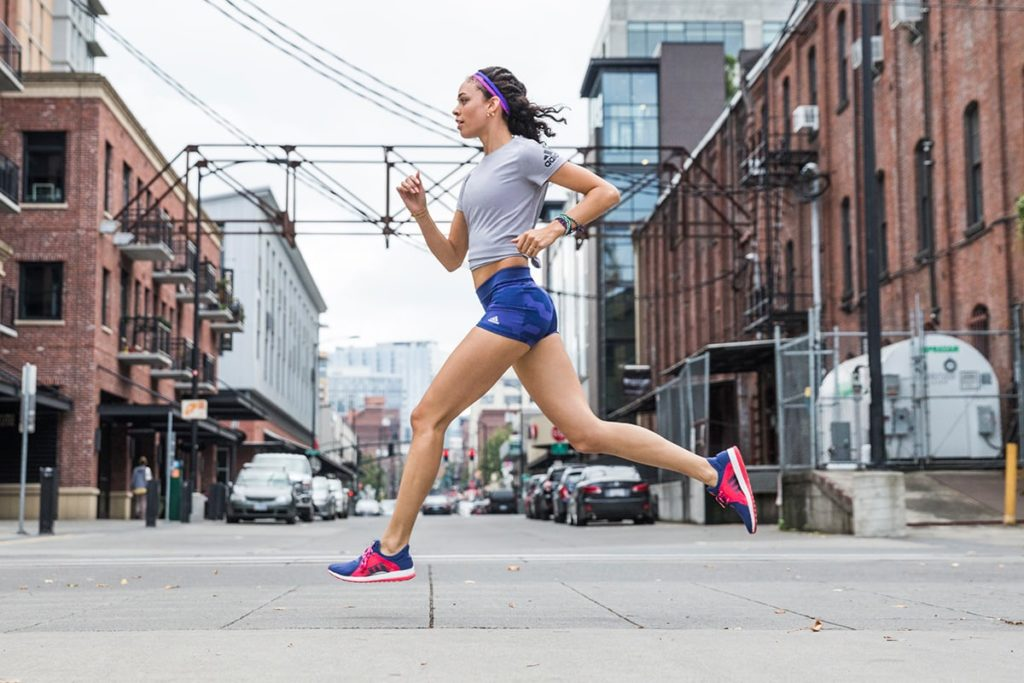 Woman running through the city