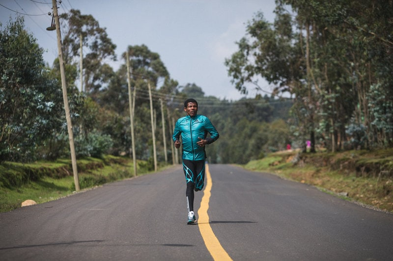 Haile Gebrselassie running on the street