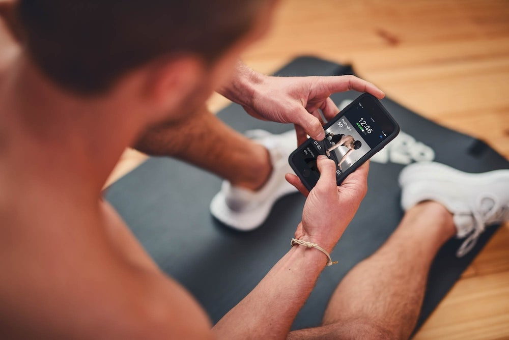 Man working out with an app