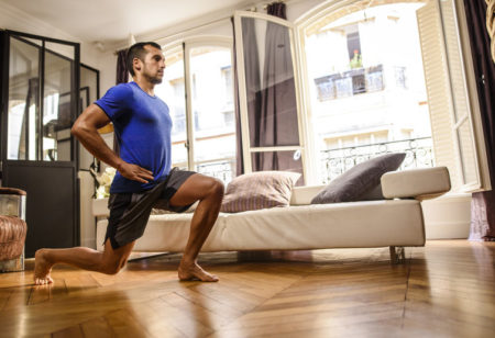 Young man doing a bodyweight training at home.