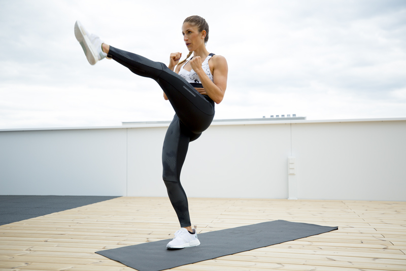 Woman is doing a lunge front kick