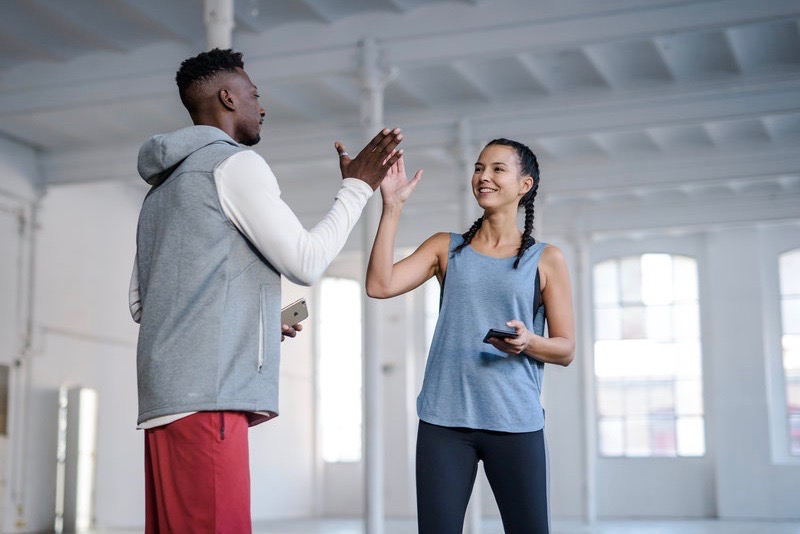 A man and a woman doing a high five
