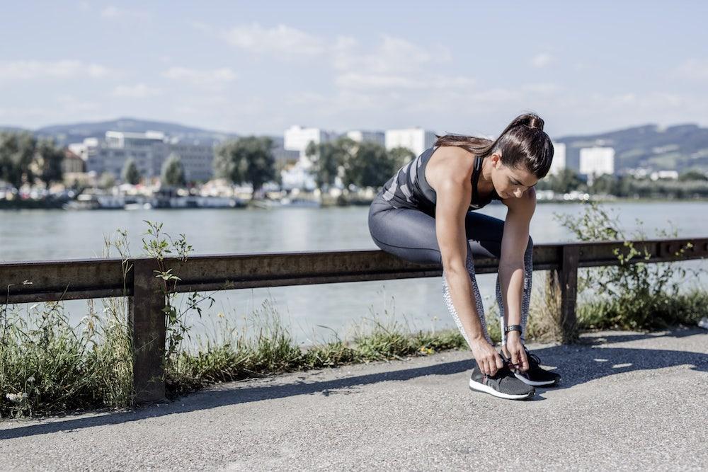 Woman getting ready to run