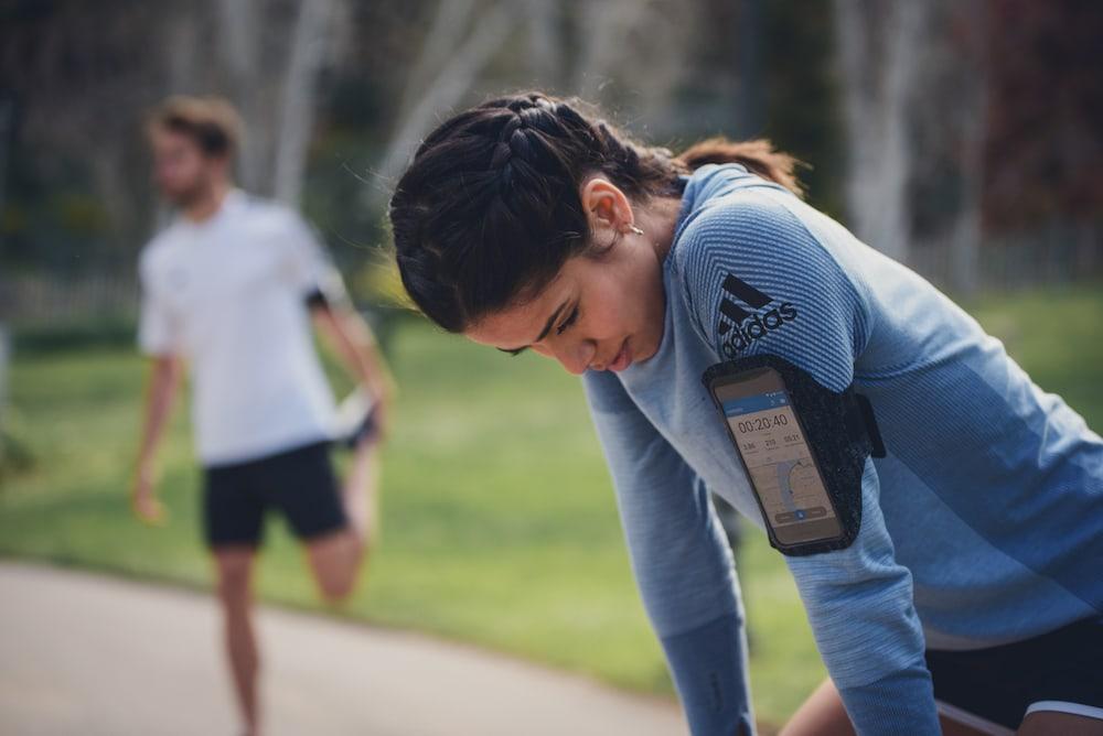 Woman and man preparing for a run
