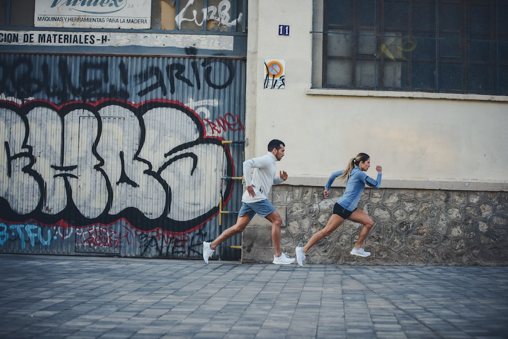 Male and female runner training together