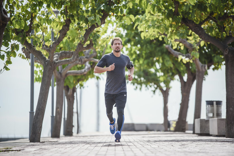 Young man running in the park.