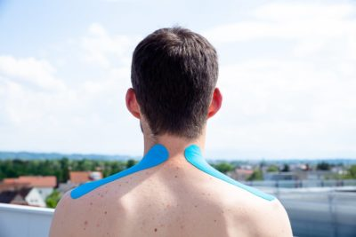 Taping the neck with kinesio tape