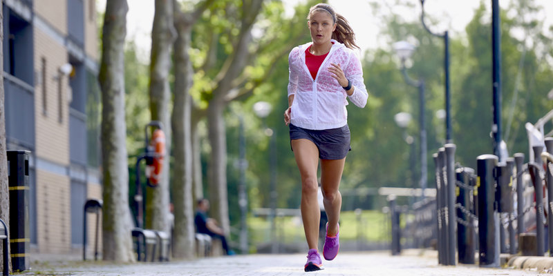 A woman running on the street