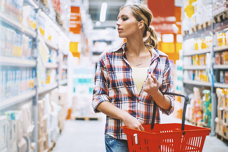 A woman is shopping in the supermarket