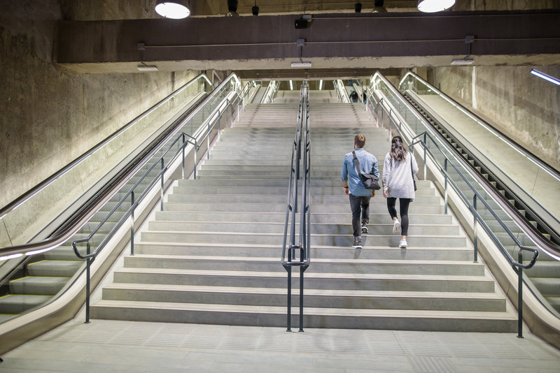 A man and a woman walking up the stairs