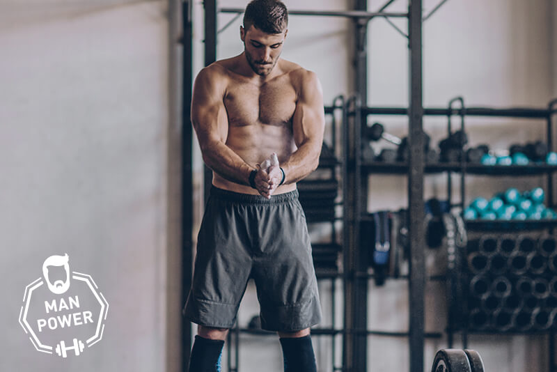 Fit athlete preparing for deadlifts in the gym.