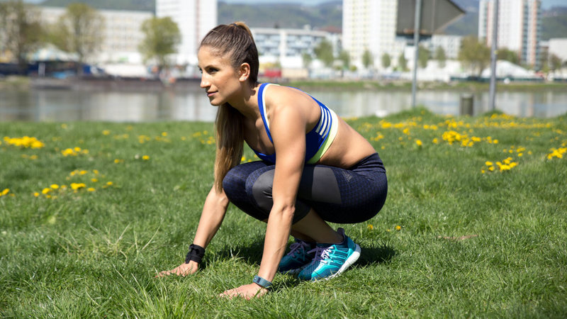Young woman is doing a Flat Out Burpee.