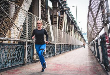 Woman running on the bridge