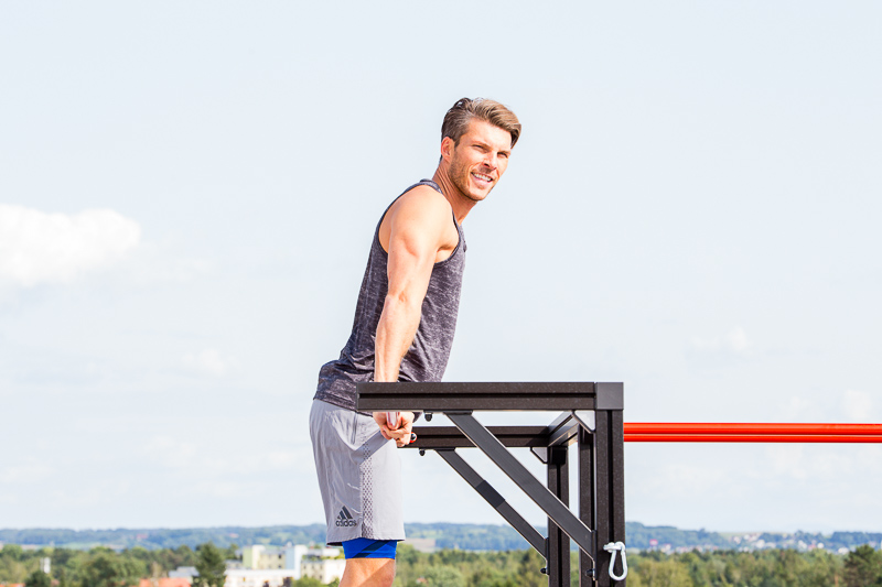 Man is training on a pull up bar