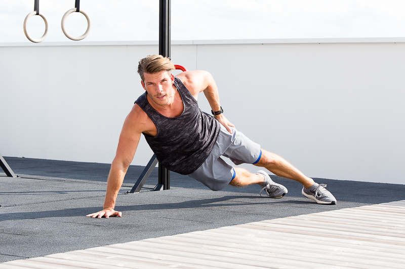 A young man working out outside