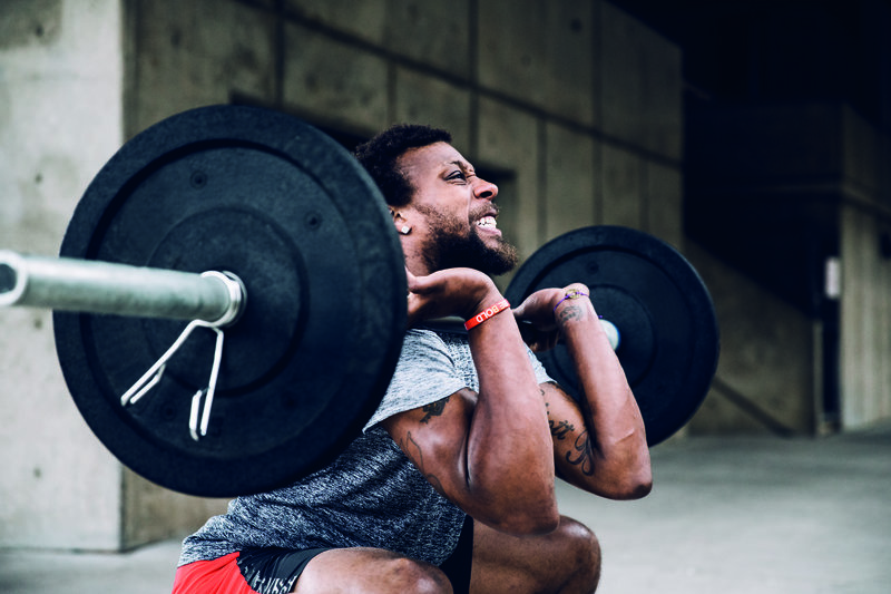 A man doing heavy front squats