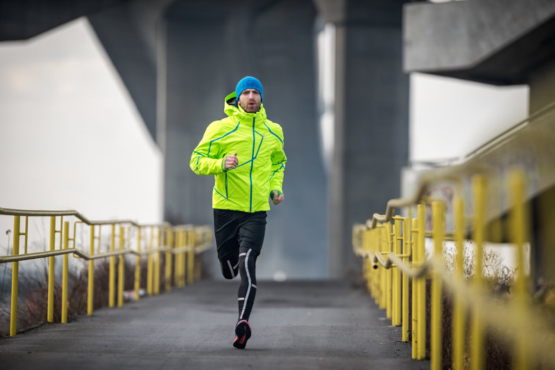 Sportsman running over the bridge during his cardio routine on a winter  day. He is 6eabdba2d51