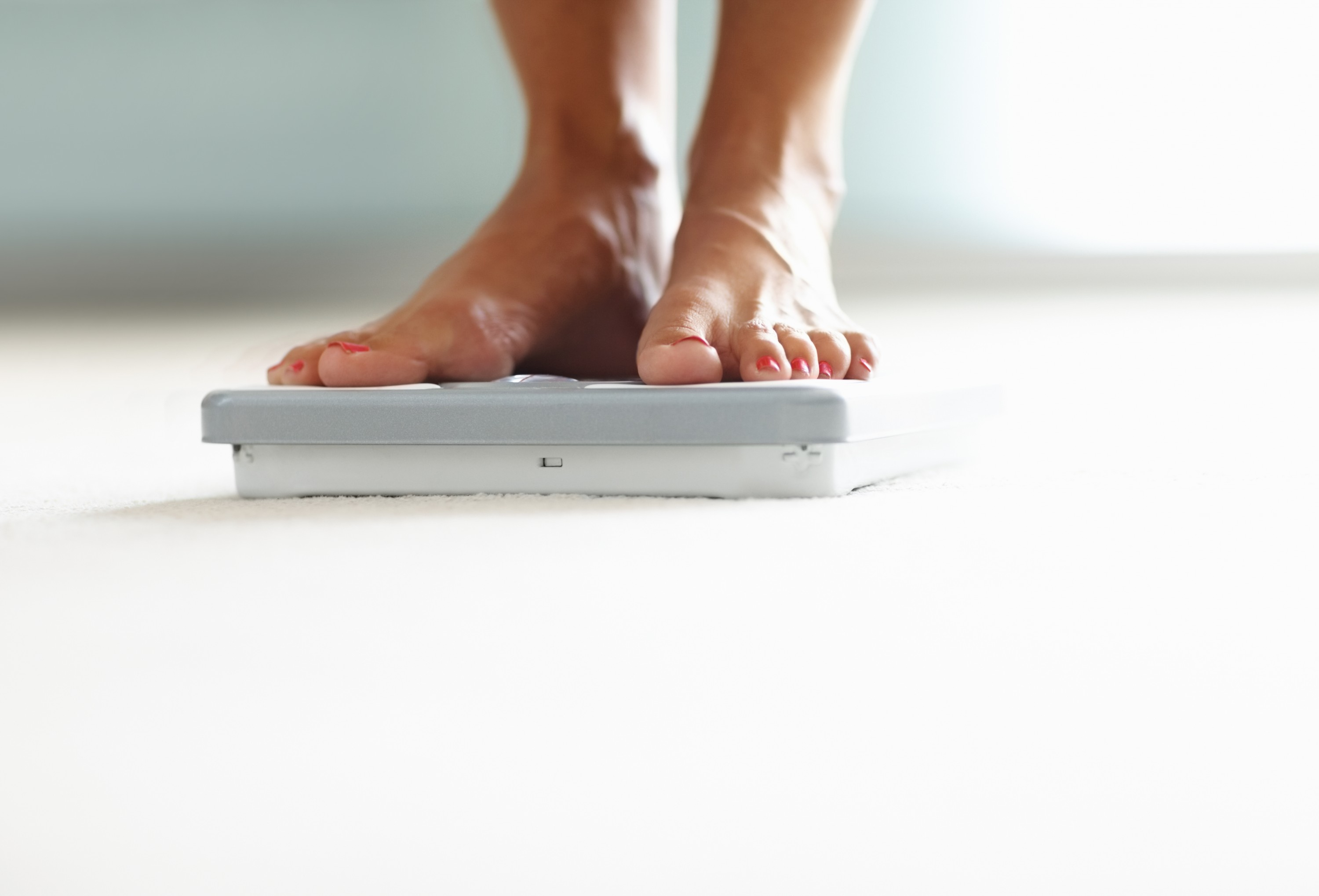 Picture detail of a person who ist standing on a scale.