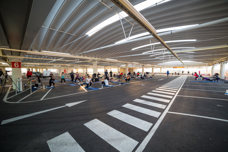 Group of people working out together in a underground carpark