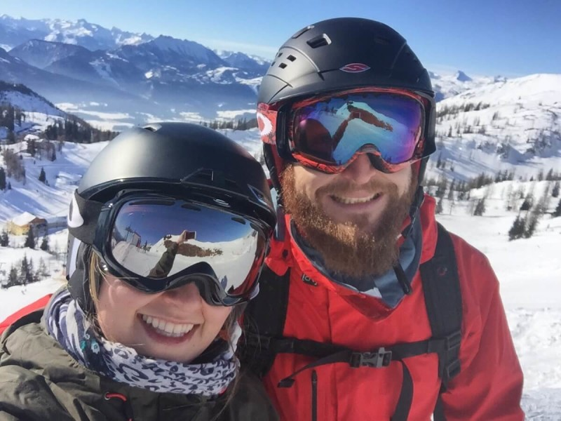 Selfie of a young couple in skiing outfit