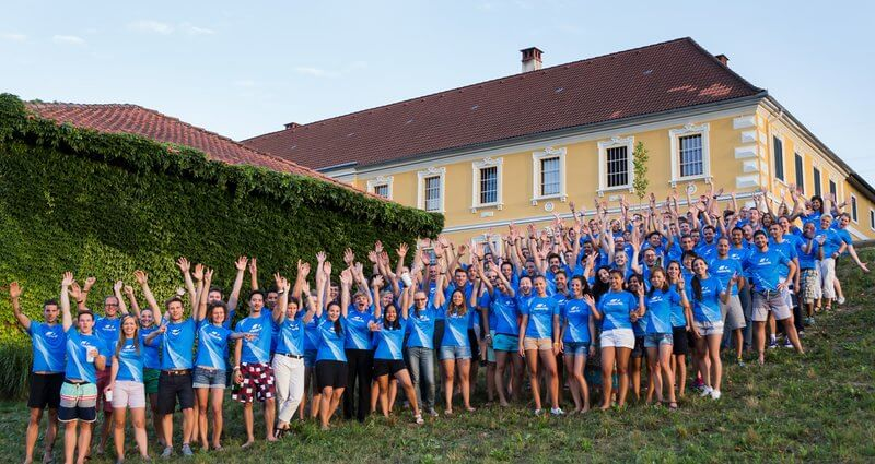 Group shot of Runtastic employees on a hill.