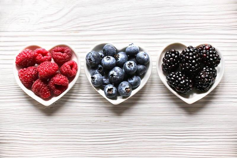 Picture of raspberries, blueberries and blackberries.