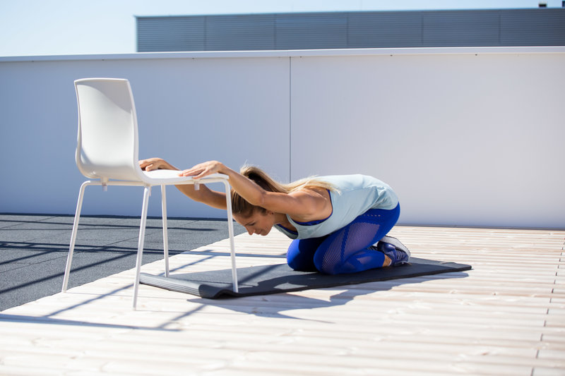 Woman doing a lat stretch