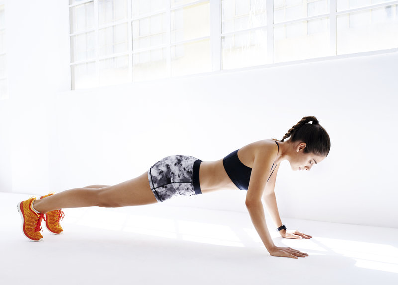 Shot of an attractive young woman doing pushups