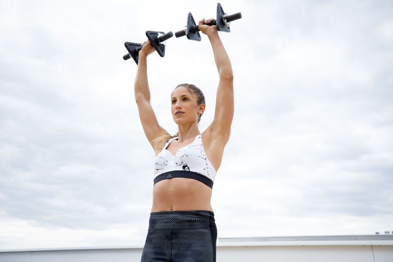 Woman is doing a shoulder press