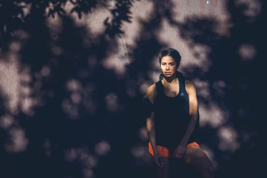 woman resting in sports clothes in the shadow