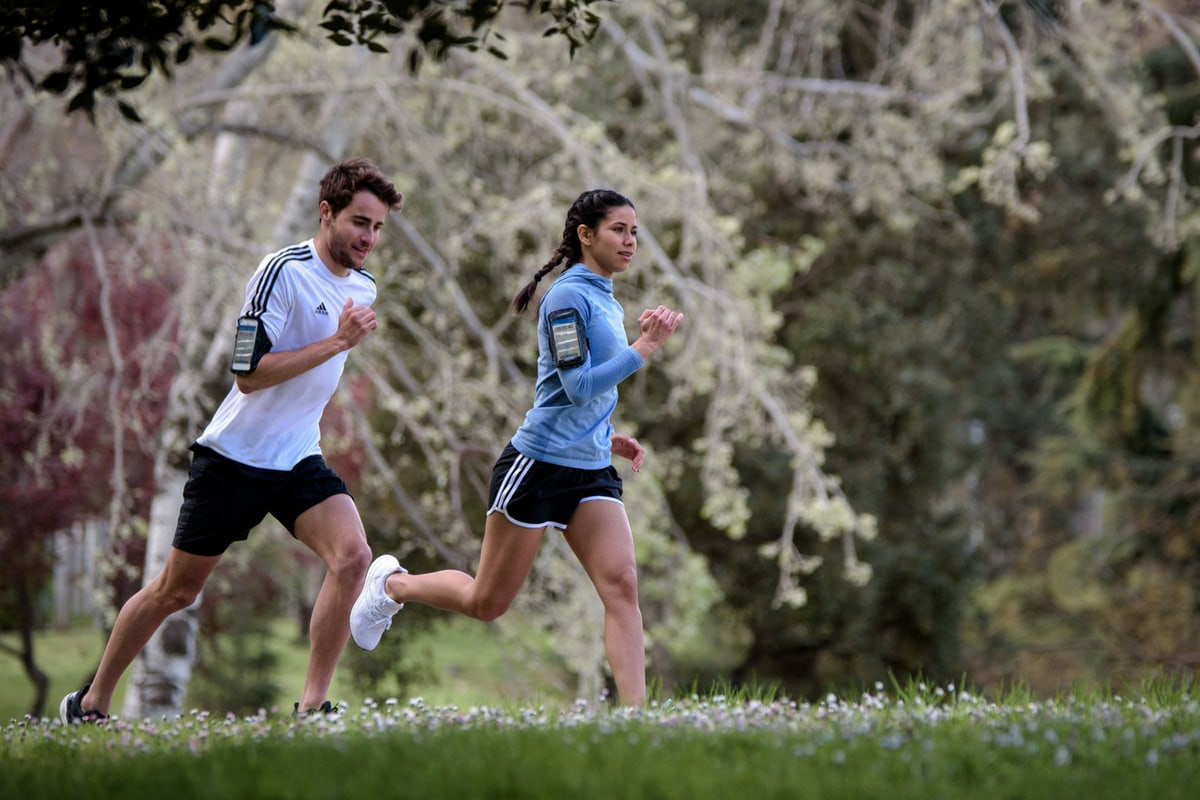 Two people running together