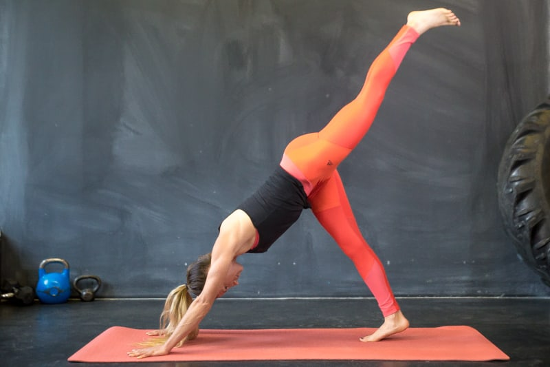 tiger curl yoga pose