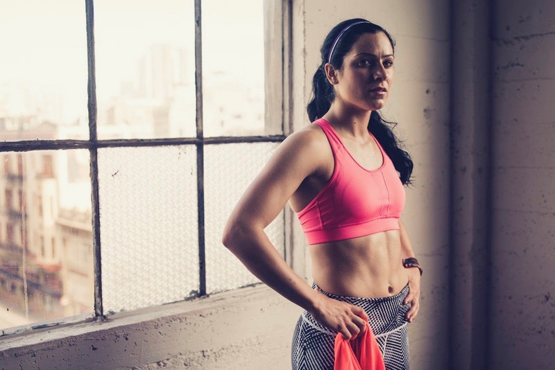 A woman in the gym after her training