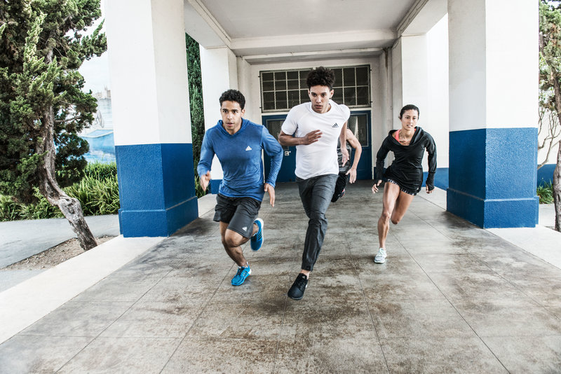 Group of friends running.