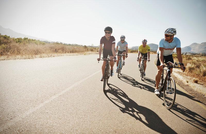 Four friends on a bike trip.