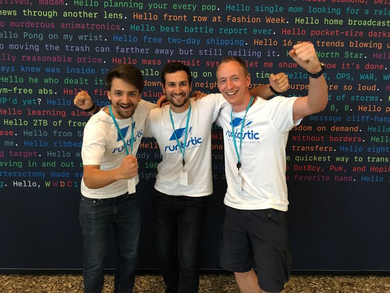 Three men in Runtastic t-shirts are raising their hands in front of a WWDC 2016 poster.