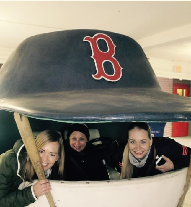 Three girls in a giant Baseball Cap.