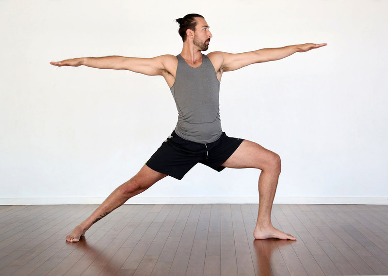 Young man doing a yoga pose.