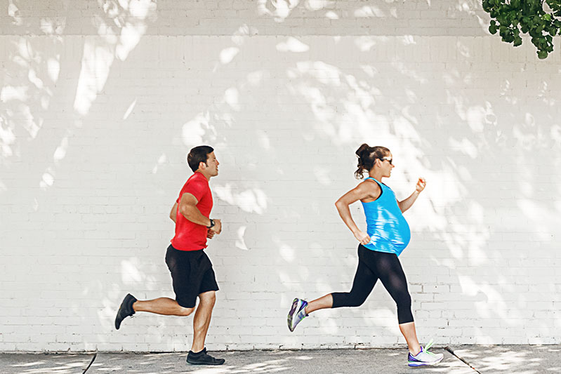 Pregnant woman is running with her husband.
