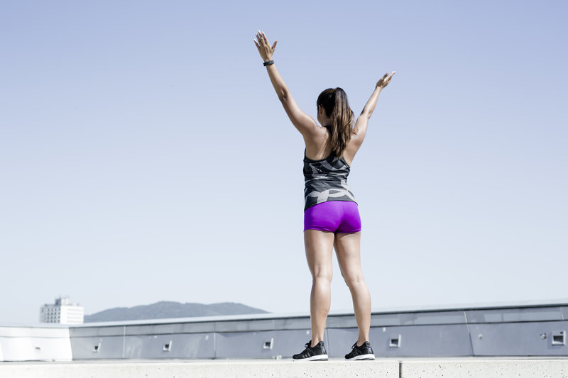 Young woman cheering after her workout.