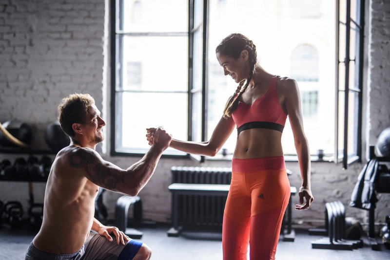 Fitness couple training together in the gym.