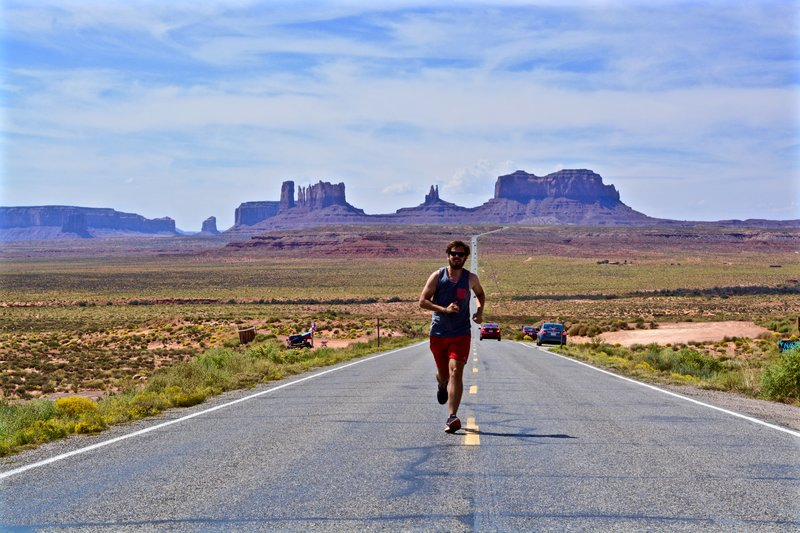 A man running on the street in the desert