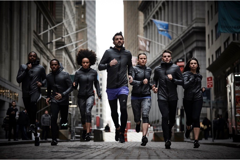 A group of people running in the city