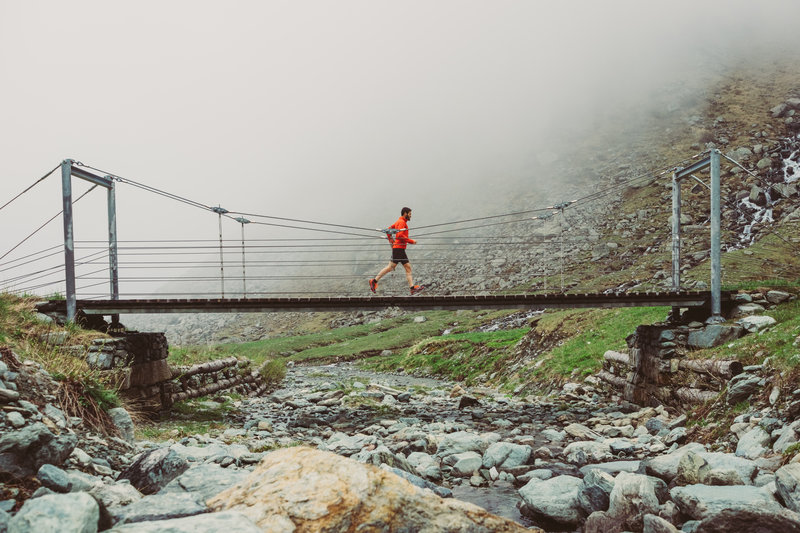 A man running on a trail path early in the morning