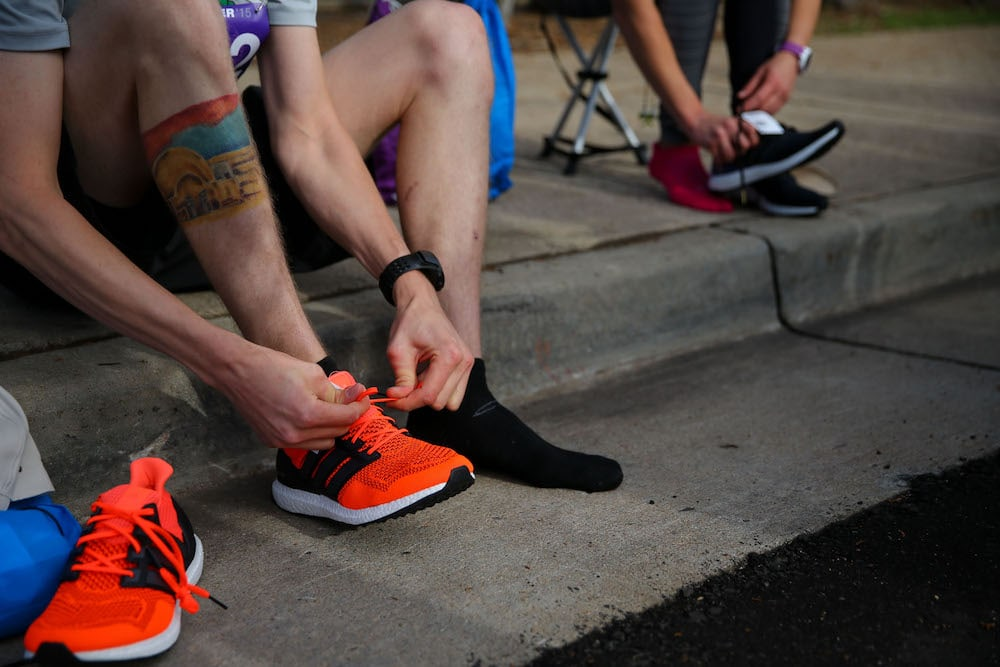 Runner putting on his shoes